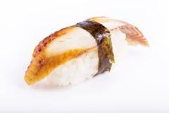 Japanische Küche, Sushi mit Aal auf einem weißen Hintergrund Lizenzfreie Stockfotos