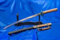 Japanische katana Klinge Die Waffe eines Samurais Eine beeindruckende Waffe in den Händen eines Meisters von Kampfkünsten Stockfoto