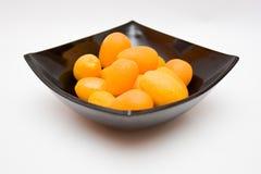 Japanische Orangen in einer Schüssel Lizenzfreies Stockbild