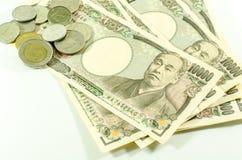 Japanische Yen und thailändisches Bad für Werbung Lizenzfreie Stockbilder
