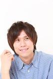 Japanischer Mann, der an seiner Zukunft träumt Lizenzfreies Stockfoto
