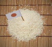 Japanischer Reis und Japan-Flagge stockfotos
