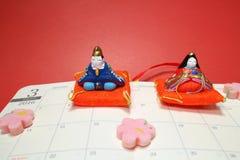 Japanisches Puppenfestival auf der März-Seite #2 Buch mit 2016 Zeitplänen Stockbilder