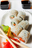 Japanisse sushi. Japanisse roll fish with soy sauce and wasabi Stock Photos