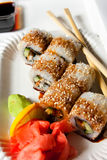 Japanisse sushi. Japanisse roll fish with soy sauce and wasabi Royalty Free Stock Photos