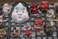 Japanmaskeringarna i marknad Arkivbild