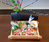Japans decorative food. Japans raw seafood in wooden tray Stock Photos