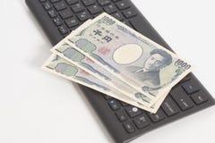 Japans geld duizend Yen op computertoetsenbord Stock Afbeelding