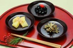 Japans nieuw jaar feestelijk voedsel, osechiryori Stock Foto's