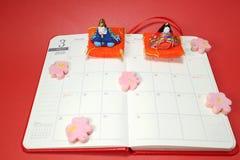 Japans poppenfestival over de van het het programmaboek van 2016 pagina van Maart Stock Afbeelding