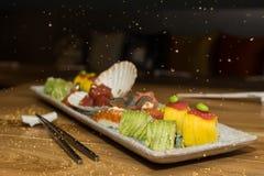 Japans voedsel met gouden vlokken op lucht Stock Afbeelding