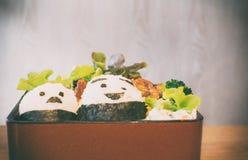 Japanse Bento met beeldverhaalkarakter Stock Foto's
