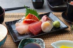 Japanse die shashimi met rijst wordt geplaatst royalty-vrije stock foto
