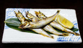 Japanse gebraden vissen met citroen Stock Foto's