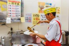 Japanse kerriechef-kok in Osaka Stock Foto's