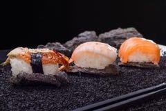 Japanse keuken sushi op achtergrond Stock Foto