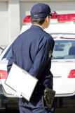 Japanse politieman met patrouillewagen Royalty-vrije Stock Afbeelding