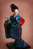 Japanse porseleinpop in blauwe kimono Stock Fotografie