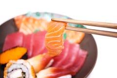 Japanse voedselsushi en Sashimi Stock Afbeeldingen