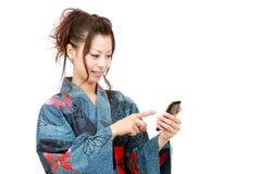 Japanse vrouw met kimono Royalty-vrije Stock Foto's