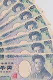 Japanse Yen, 1000 Yen op witte achtergrond, de Japanse bank van de muntyen royalty-vrije stock afbeelding