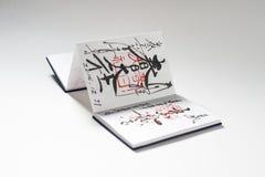 Japansk anteckningsbok med stämplar och kalligrafi royaltyfri fotografi
