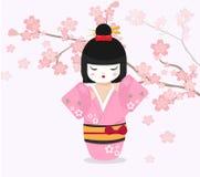 Japansk docka med bakgrund för körsbärsrött träd Arkivfoto