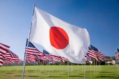 Japansk flagga bland 3000na Royaltyfria Bilder