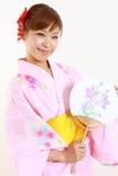 Japansk kimono med den pappers- fanen Royaltyfri Bild