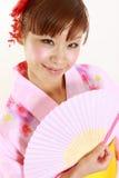 Japansk kimono med den pappers- fanen Royaltyfria Bilder