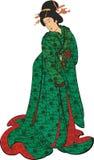 Japansk kvinna i en grön kimono Arkivbild