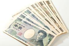 Japansk sedelyen 10000 yen och 1000 Arkivbilder