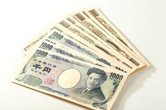 Japansk sedelyen 10000 yen och 1000 Arkivbild