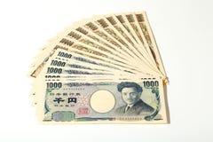 Japansk sedelyen 10000 yen och 1000 Fotografering för Bildbyråer