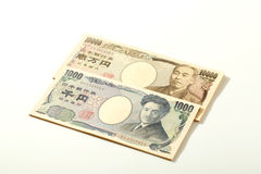 Japansk sedelyen 10000 yen och 1000 Royaltyfri Fotografi