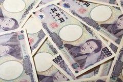 Japansk yen för sedel 5000 av bakgrund Arkivfoto