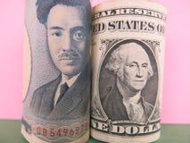 Japansk yen och US dollar Arkivfoto