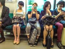 Japanska pendlare arkivbild