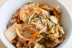 Japanska ris med koreansk kimchi arkivfoton