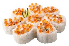 Japanska sushirullar på vit bakgrund Arkivfoto