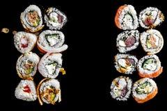 Japanska traditionella sushirullar med rökte ålfyllningar, slut upp arkivfoto