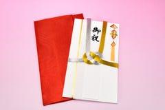 Japanskt gåvakuvert och kräppomslag Royaltyfri Bild