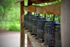 Japen religion bell. Seven bronze religion bell in japanese zen garden intended for moulting Stock Photos