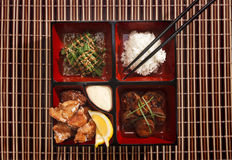 Japenese Food. Japanese food in a bento box on a bamboo style place mat Stock Photo