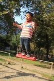 Japońska chłopiec na huśtawce Zdjęcia Royalty Free