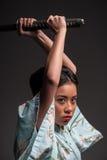 Japońska kobieta z kataną Zdjęcia Stock