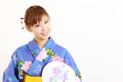 Japoński kimono z papierowym fan Obrazy Stock