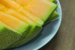 Japoński melonowy obruszenie owoc tło Zdjęcia Stock