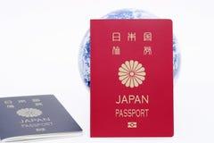 Japońska paszporta i ziemi kula ziemska Fotografia Royalty Free