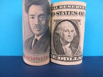 Japoński jen i USA dolary Obrazy Royalty Free